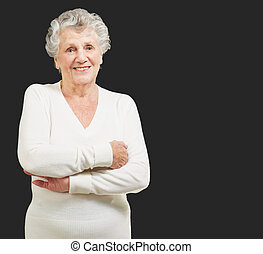 Portrait Of A Senior Woman On Black Background