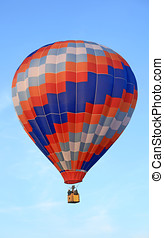 Vivid hot air balloon floating in the blue sky.