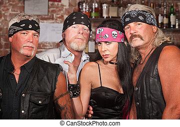 Biker Gang Members with Woman - Tough male biker gang...