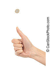 Woman hand tossing a coin on a white isolated background...