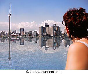 toronto reflections - Woman looks over the water at Toronto,...