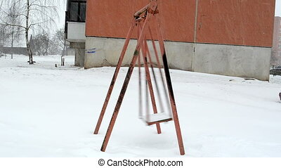 swing move winter snow - empty swing seat move in winter...