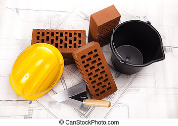 Construction plans and blueprints, bricks