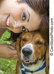 Best Buddies - A pretty girl posing with her beagle dog....