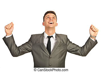 Successful business man cheering isolated on white...