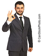 Successful business man showing okay sign hand gesture...