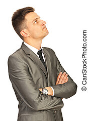 Confused business man looking up isolated on white...