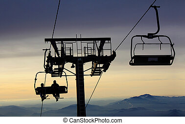 Ski lift - Ski-lift transports skiers to the top of the...