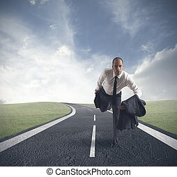 Fast business concept with businessman running on the road