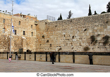 Jewish worshipers pray at the Wailing Wall - Jewish...