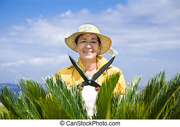 gardening - Portrait of senior Italian woman gardening with...