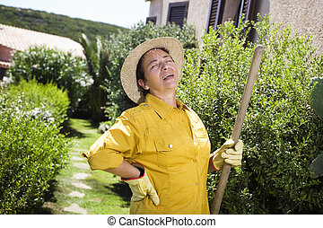 gardening - Tired senior Italian woman having backache while...
