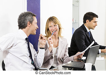 Bureau - Businesspeople talking in meeting room. Businessman...