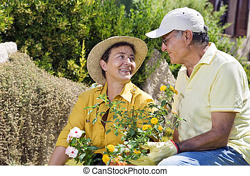 gardening - Portrait of senior Italian couple in garden