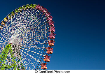 ferris wheel isolated on blue, working in the fair of...