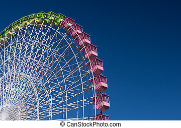 in the fair - ferris wheel isolated on blue, working in the...