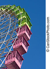 portion of a ferris wheel isolated on blue, working in the...
