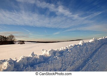 snow landscape - a snow landscape with a path and blue sky