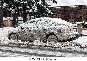 Car in dirty snow on side of the road - Car splashed on by...