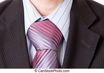 Closeup of a business man. Necktie and suit.