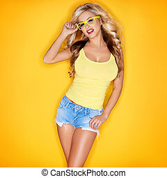 Young Woman In Yellow Tanktop And Eye Glasses Against Yellow...