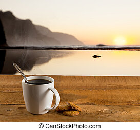 Cup of coffee on wooden table by ocean - Coffee in white...