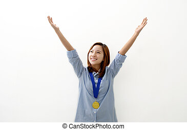 Gold Medal Winner - A young woman happily holds up her arms...