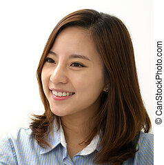 Friendly Smile - A young attractive businesswoman with a...