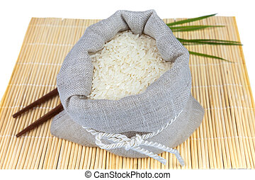 Sack of white rice on the mat - Macro view of sack of white...