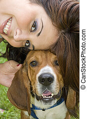 Best Buddies - A pretty girl posing with her beagle dog -...
