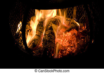 Chiminea Fire - A red hot fire burning in a backyard...