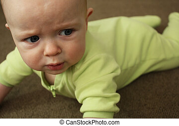 Meltdown I - A close-up of a baby in a light green outfit on...