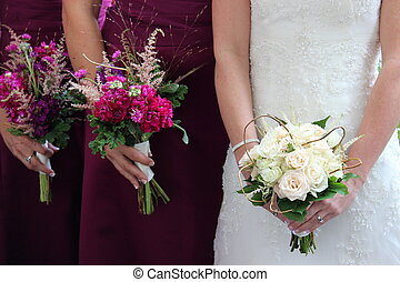 Bride and bridesmaids and flowers - Bride and her attendants...
