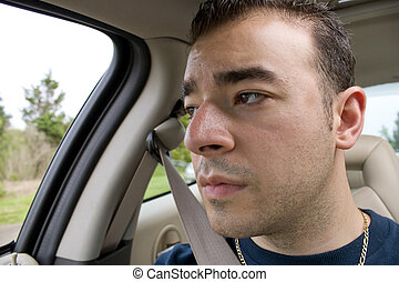 Bored Car Passenger - This young man looks bored and stares...