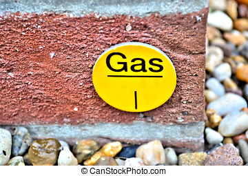 sign - A sign as an indication of a gas pipe in the ground