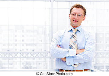 business man crossed his arms and looking in the camera
