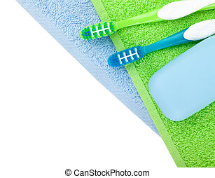 Toothbrushes and soap over towels View from above