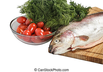 Salmon with greenery - Salmon on the cutting board with...