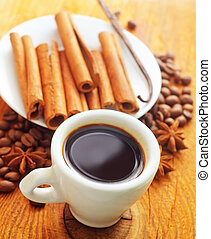 cinnamon and coffee on the white plate