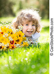 Bouquet of flowers - Happy child with bouquet of spring...