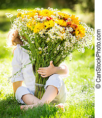 Bouquet of flowers - hild hiding behind big bouquet of...