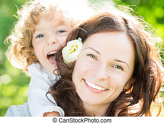 Mother day - Happy woman and child in spring park