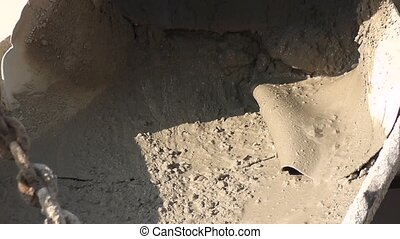 Concrete in a mixer pouring - View of freshly mixed concrete...