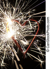 Heart shaped firework represents valentine concept.