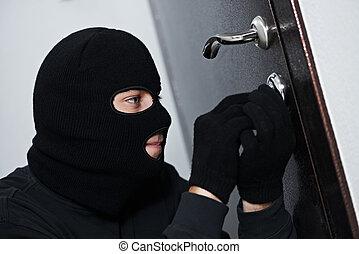 burglar thief at house breaking - Thief Burglar force lock...