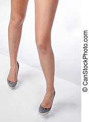 High Heels - Legs with high heels isolated against a white...