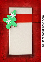 Christmas card with tree cookie on fabric background