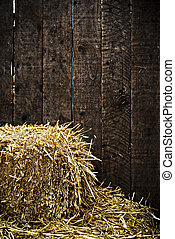 Bale of straw and wooden background - Bale of straw and dark...
