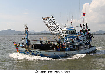 Fishing trawler and sea coast in Thailand