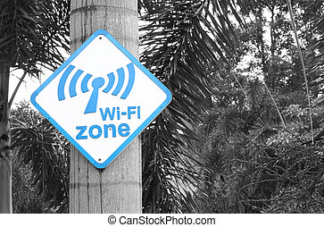 Wi-Fi zone sign on tree in the garden